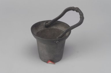 Unknown. <em>Pail with Handle</em>, 19th century. Pewter, With handle upright: 4 3/8 x 2 3/4 x 2 3/4 in. (11.1 x 7 x 7 cm). Brooklyn Museum, Gift of Mrs. Samuel Doughty, 27.604. Creative Commons-BY (Photo: Brooklyn Museum, 27.604.jpg)