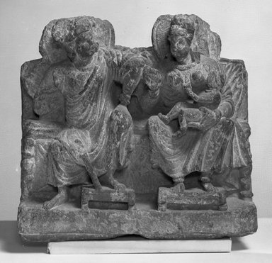Graeco-Buddhistic. <em>Small Relief of Hariti</em>, late 2nd-3rd century. relief fragment, black slate , 7 3/4 x 2 9/16 x 8 1/4 in. (19.7 x 6.5 x 21 cm). Brooklyn Museum, Gift of Frederic B. Pratt, 27.65. Creative Commons-BY (Photo: Brooklyn Museum, 27.65_acetate_bw.jpg)