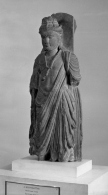Buddhist. <em>Medium Sized Standing Figure of a Bodhisattva</em>, late 2nd to 3rd century C.E. Sculpture, grey schist, 16 15/16 x 6 5/16 in. (43 x 16 cm). Brooklyn Museum, Gift of Frederic B. Pratt, 27.66. Creative Commons-BY (Photo: Brooklyn Museum, 27.66_acetate_bw.jpg)