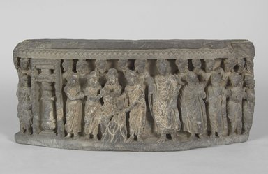 <em>Relief of Shakyamuni and Jivaka Taking the Infant Jyotishka from the Pyre</em>, late 2nd to 3rd century C.E. Sculpture, 7 7/8 x 3 x 17 11/16 in. (20 x 7.6 x 45 cm). Brooklyn Museum, Gift of Frederic B. Pratt, 27.68. Creative Commons-BY (Photo: Brooklyn Museum, 27.68_PS5.jpg)