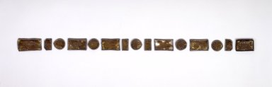 <em>Set of 15 Belt Ornaments (Ttidon)</em>, 19th century. Plastic, metal, wood, gilded paper, large rectangular pieces: 1 9/16 x 3 1/16 x 3/16 in. (4 x 7.8 x 0.5 cm). Brooklyn Museum, Brooklyn Museum Collection, 27.977.17a-o. Creative Commons-BY (Photo: Brooklyn Museum, 27.977.17a-o.jpg)