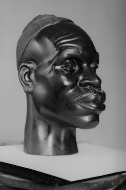 Malvina Hoffman (American, 1885-1966). <em>Senegalese Soldier</em>, 1928. Black stone, 20 x 10 x 15 in. (50.8 x 25.4 x 38.1 cm). Brooklyn Museum, Dick S. Ramsay Fund, 28.385. © artist or artist's estate (Photo: Brooklyn Museum, 28.385_acetate_bw.jpg)