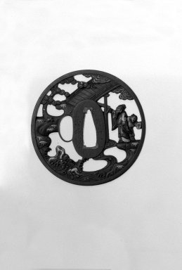 <em>Sword Guard</em>, 18th century. Iron, chiseled and pierced and with extensive gilding, 1/8 x 2 11/16 in. (0.3 x 6.8 cm). Brooklyn Museum, Gift of F. Ethel Wickham, 28.601. Creative Commons-BY (Photo: Brooklyn Museum, 28.601_front_bw.jpg)