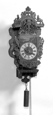 <em>Painted Clock</em>, early 18th century. Wood, metal, pigment, 31 1/4 x 13 3/8 x 9 3/4 in. (79.4 x 34 x 24.8 cm). Brooklyn Museum, Museum Collection Fund, 28.749. Creative Commons-BY (Photo: Brooklyn Museum, 28.749_bw.jpg)