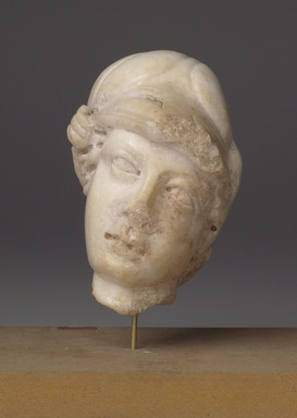 Roman. <em>Head of Athena</em>, 2nd-3rd century C.E. Marble, 4 1/2 x 3 3/8 x 2 13/16 in. (11.5 x 8.5 x 7.2 cm). Brooklyn Museum, Gift of Bianca Olcott in memory of her father, Professor George M. Olcott of Columbia University, of her grandfather, George N. Olcott, and of her great-grandfather, Charles M. Olcott, President of the Brooklyn Institute of Arts and Sciences 1851-1853, 29.1603. Creative Commons-BY (Photo: Brooklyn Museum, 29.1603_front.jpg)