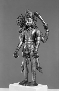 <em>Standing Figure of Vishnu</em>, 10th century. Gilt bronze (high copper content), 9 11/16 in. (24.6 cm). Brooklyn Museum, Gift of Frederic B. Pratt, 29.18. Creative Commons-BY (Photo: Brooklyn Museum, 29.18_front_acetate_bw.jpg)