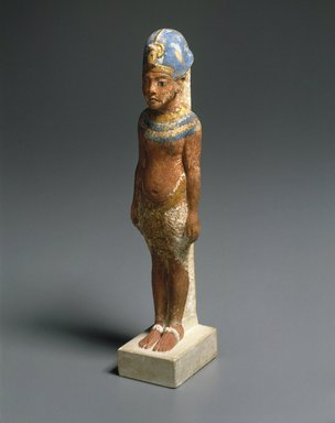 <em>Amarna King</em>, ca. 1352-1336 B.C.E. Limestone, pigment, gold leaf, 8 3/8 x 1 7/8 in. (21.3 x 4.8 cm). Brooklyn Museum, Gift of the Egypt Exploration Society, 29.34. Creative Commons-BY (Photo: Brooklyn Museum, 29.34_threequarter_SL1.jpg)