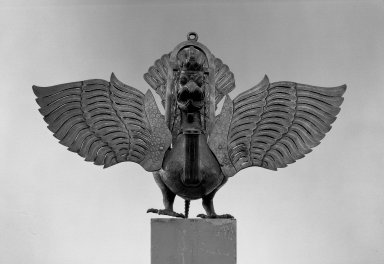 <em>Lamp in the Form of the Mythical Garuda Bird</em>, 19th century. Brass, approximate: 20 7/8 x 39 3/4 in. (53 x 101 cm). Brooklyn Museum, Alfred T. White Fund, 30.1171. Creative Commons-BY (Photo: Brooklyn Museum, 30.1171_front_acetate_bw.jpg)