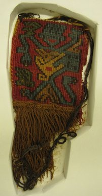 Nazca-Wari. <em>Textile Fragment, Unascertainable or Mantle, Corner Tassel, Fragment</em>, 200-1000 C.E. Cotton, camelid fiber, 9 13/16 x 4 5/16in. (25 x 11cm). Brooklyn Museum, Gift of George D. Pratt, 30.1206. Creative Commons-BY (Photo: Brooklyn Museum, 30.1206.jpg)