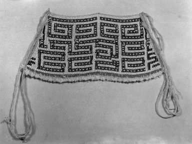Makushi-Monaiko. <em>Woman's Apron</em>, early 20th century. Glass beads, cotton, 5 7/16 × 11 1/4 × 11/16 in. (13.8 × 28.6 × 1.7 cm), not including tassels. Brooklyn Museum, Museum Expedition 1930, Robert B. Woodward Memorial Fund and the Museum Collection Fund, 30.1355. Creative Commons-BY (Photo: Brooklyn Museum, 30.1355_glass_bw.jpg)