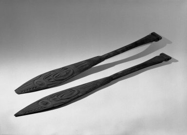 Tlingit. <em>Flat Carved Paddle, One of Pair</em>, 19th century. Wood, 24 7/8 x 3 3/16 in. (63.2 x 8.1 cm). Brooklyn Museum, Gift of Charlotte Elizabeth Dudley, 30.1468.1. Creative Commons-BY (Photo: , 30.1468.1_30.1468.2_acetate_bw.jpg)