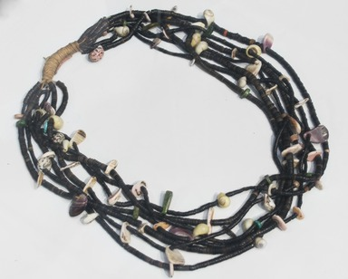 She-we-na (Zuni Pueblo). <em>Necklace</em>, ca. 1100-1300. Stone, shell, plant fiber, 11 1/2 x 8 1/2 in. (29.2 x 21.6 cm). Brooklyn Museum, Estate of Stewart Culin, Museum Purchase, 30.808. Creative Commons-BY (Photo: Brooklyn Museum, 30.808_installation_PS5.jpg)