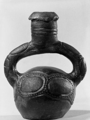 Mangbetu. <em>Stirrup-spout Jar</em>, early 20th century. Terracotta, 9 1/4 x 7 1/4 x 5 in. (23.5 x 18.5 x 12.7 cm). Brooklyn Museum, Museum Expedition 1931, Robert B. Woodward Memorial Fund, 31.1820. Creative Commons-BY (Photo: Brooklyn Museum, 31.1820_front_view_acetate_bw.jpg)