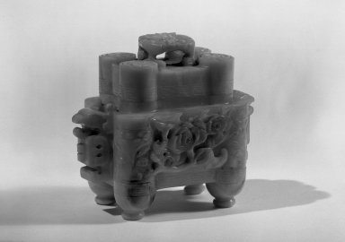 <em>Rather Small Covered Incense Burner and Stand</em>, 19th century. Jadeite, wood, 5 1/2 x 2 1/2 x 4 3/4 in. (14 x 6.3 x 12 cm). Brooklyn Museum, Gift of the executors of the Estate of Colonel Michael Friedsam, 32.1290a-c. Creative Commons-BY (Photo: Brooklyn Museum, 32.1290a-c_acetate_bw.jpg)