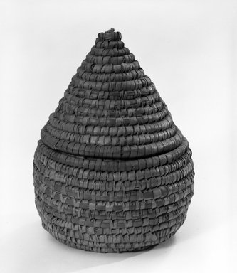 <em>Cone Shaped Basket with Cover</em>, early 20th century. Reed, raffia, height: (15.2 cm). Brooklyn Museum, Gift of Theodora Wilbour, 32.1760a-b. Creative Commons-BY (Photo: Brooklyn Museum, 32.1760a-b_bw.jpg)