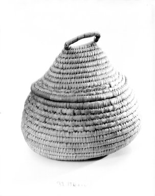 <em>Oval and Cone Shaped Basket with Cover</em>, early 20th century. Fiber, (22.2 x 17.0 x 21.5 cm). Brooklyn Museum, Gift of Theodora Wilbour, 32.1761a-b. Creative Commons-BY (Photo: Brooklyn Museum, 32.1761_bw.jpg)