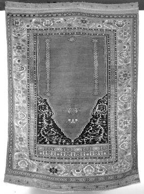 <em>Prayer Carpet</em>, early 18th century. Warp: undyed white wool, z2S, 1 level Weft: red wool, z1S, 2 shoots Pile: wool, z2S , Dims: 65 1/2 x 47 1/4 in. (166.4 x 120 cm). Brooklyn Museum, Gift of Horace O. Havemeyer, 32.2087. Creative Commons-BY (Photo: Brooklyn Museum, 32.2087_bw.jpg)
