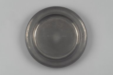 Shelton & Feltman (American, active 1847). <em>Dish or Paten</em>, ca. 1847. Pewter, 1 x 10 1/4 x 10 1/4 in. (2.5 x 26 x 26 cm). Brooklyn Museum, Gift of Theodora Wilbour, 32.2089. Creative Commons-BY (Photo: Brooklyn Museum, 32.2089.jpg)