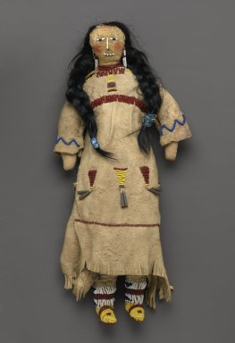 Cheyenne (Plateau). <em>Doll</em>, early 20th century. Buckskin, animal hair, beads, cloth, pigment, metal cones, 15 15/16 x 6 5/16 in. (40.5 x 16 cm). Brooklyn Museum, Bequest of W.S. Morton Mead, 32.2099.32542. Creative Commons-BY (Photo: Brooklyn Museum, 32.2099.32542_PS2.jpg)