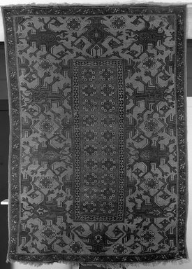<em>Holbein-derivative Carpet</em>, 19th century. Wool, Old Dims: 84 x 60 in. (213.4 x 152.4 cm). Brooklyn Museum, Gift of the executors of the Estate of Colonel Michael Friedsam, 32.548. Creative Commons-BY (Photo: Brooklyn Museum, 32.548_acetate_bw.jpg)