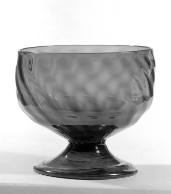 American. <em>Round Green Bowl With Base</em>, 19th century. Glass, 3 9/16 x 3 15/16 in. (9 x 10 cm). Brooklyn Museum, Gift of Theodora Wilbour, 32.525.95. Creative Commons-BY (Photo: Brooklyn Museum, 32.591_bw.jpg)