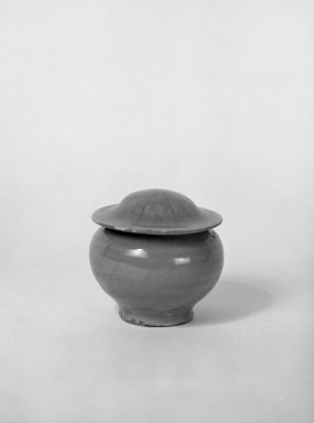 <em>Jar with Cover</em>, 1271-1368. High-fired green-ware (celadon), 3 3/4 x 3 7/8 in. (9.5 x 9.8 cm). Brooklyn Museum, Gift of the executors of the Estate of Colonel Michael Friedsam, 32.910a-b. Creative Commons-BY (Photo: Brooklyn Museum, 32.910a-b_bw.jpg)