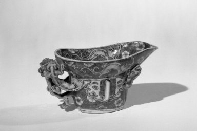 <em>Libation Cup and Stand</em>, 1662-1722. Porcelain with three-color (sancai) glaze, 2 3/16 x 4 3/16 in. (5.5 x 10.6 cm). Brooklyn Museum, Gift of the executors of the Estate of Colonel Michael Friedsam, 32.954. Creative Commons-BY (Photo: Brooklyn Museum, 32.954_acetate_bw.jpg)