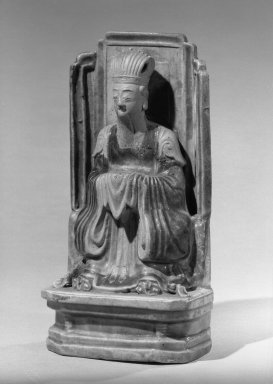 <em>Figure Seated On a Throne</em>, late 16th-early 17th century. Porcelain with three-color (sancai) glaze., 8 1/4 x 4 1/8 in. (21 x 10.5 cm). Brooklyn Museum, Gift of the executors of the Estate of Colonel Michael Friedsam, 32.960. Creative Commons-BY (Photo: Brooklyn Museum, 32.960_acetate_bw.jpg)