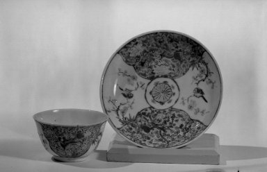 <em>Cup and Saucer</em>, 1723-1735. Porcelain with famille rose decoration, a: 1 9/16 x 2 3/4 in. (3.9 x 7 cm). Brooklyn Museum, Gift of the executors of the Estate of Colonel Michael Friedsam, 32.975a-b. Creative Commons-BY (Photo: Brooklyn Museum, 32.975a-b_acetate_bw.jpg)