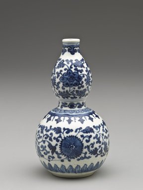 <em>Vase of Double Gourd Shape</em>, 1662-1722. Porcelain with cobalt-blue underglaze decoration (roasted blue-and-white), 5 3/16 x 2 15/16 in. (13.2 x 7.5 cm). Brooklyn Museum, Gift of the executors of the Estate of Colonel Michael Friedsam, 32.983. Creative Commons-BY (Photo: Brooklyn Museum, 32.983_PS6.jpg)