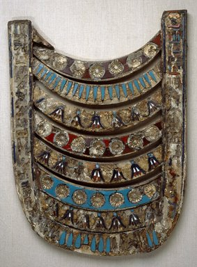 <em>Broad Collar</em>, 205-180 B.C.E. Wood, gesso, glass, 19 5/8 x 14 1/2 in. (49.8 x 36.9 cm). Brooklyn Museum, Charles Edwin Wilbour Fund, 33.383. Creative Commons-BY (Photo: Brooklyn Museum, 33.383_SL1.jpg)