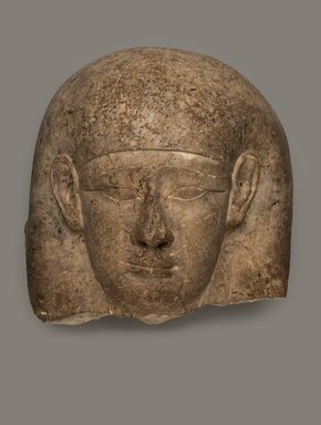 <em>Head from a Sarcophagus Lid</em>, 381–30 B.C.E. Indurated limestone, 17 5/16 x 16 9/16 x 12 in., 113 lb. (44 x 42 x 30.5 cm, 51.26kg). Brooklyn Museum, Charles Edwin Wilbour Fund, 33.56. Creative Commons-BY (Photo: Brooklyn Museum, 33.56_PS11.jpg)