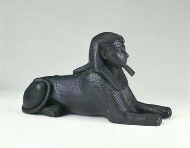 <em>Sphinx of King Sheshenq</em>, ca. 945-712 B.C.E. Bronze, 1 15/16 x 13/16 x 2 7/8 in. (4.9 x 2.1 x 7.3 cm). Brooklyn Museum, Charles Edwin Wilbour Fund, 33.586. Creative Commons-BY (Photo: Brooklyn Museum, 33.586_SL1.jpg)