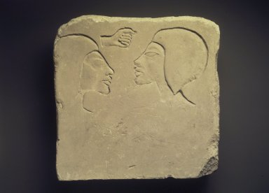 <em>Trial Piece with Two Heads</em>, ca. 1352-1336 B.C.E. Limestone, 9 3/8 × 9 5/16 × 2 1/2 in. (23.8 × 23.6 × 6.4 cm). Brooklyn Museum, Charles Edwin Wilbour Fund, 33.61. Creative Commons-BY (Photo: Brooklyn Museum, 33.61.jpg)