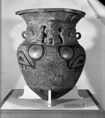 <em>Large Funerary Urn</em>. Ceramic, pigments, 41 3/4 x 32 11/16 in. (106 x 83 cm). Brooklyn Museum, Museum Expedition 1933, Purchased with funds given by Jesse Metcalf, 33.675. Creative Commons-BY (Photo: Brooklyn Museum, 33.675_view1_acetate_bw.jpg)