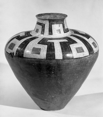 <em>Large Chicha Jar</em>. Ceramic, 25 3/16 x 8 11/16 in.  (64 x 22 cm). Brooklyn Museum, Museum Expedition 1933, Purchased with funds given by Jesse Metcalf, 33.678. Creative Commons-BY (Photo: Brooklyn Museum, 33.678_acetate_bw.jpg)