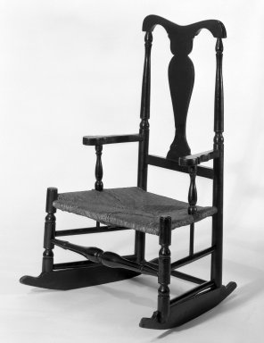 <em>Rocking Chair</em>, 18th century. Wood, Paint, rush, 40 1/2 x 24 7/16 x 16 in. (102.9 x 62.1 x 40.6 cm). Brooklyn Museum, Gift of Mrs. St. Clair McKelway, 34.1152. Creative Commons-BY (Photo: Brooklyn Museum, 34.1152_bw.jpg)