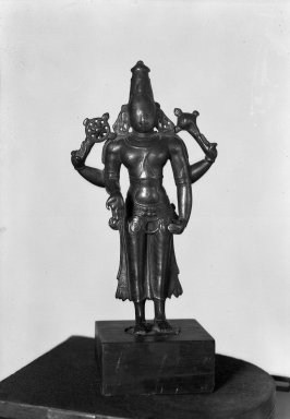 Brahmanical - Vaisnava. <em>Small Standing Four Armed Figure of Vishnu</em>, 14th century. Brass, 8 7/8 x 4 3/16 in. (22.6 x 10.6 cm). Brooklyn Museum, Brooklyn Museum Collection, 34.142. Creative Commons-BY (Photo: Brooklyn Museum, 34.142_acetate_bw.jpg)
