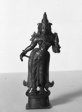 Brahmanical. <em>Figure of Lakshmi</em>, 18th-19th century. Brass, 8 1/16 x 3 1/8 in. (20.5 x 8 cm). Brooklyn Museum, Brooklyn Museum Collection, 34.143. Creative Commons-BY (Photo: Brooklyn Museum, 34.143_acetate_bw.jpg)
