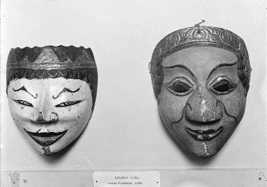 <em>Theatrical Mask</em>, 19th century. Wood, pigment, 5 11/16 x 7 5/16 in. (14.5 x 18.5 cm). Brooklyn Museum, Brooklyn Museum Collection, 34.39. Creative Commons-BY (Photo: , 34.36_34.39_glass_bw.jpg)
