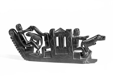 Haida. <em>Carved Pipe</em>. Argillite, 14 15/16 x 8 1/4in. (38 x 21cm). Brooklyn Museum, Gift of Dr. Clark Burnham, 34.5603.12. Creative Commons-BY (Photo: Brooklyn Museum, 34.5603.12_view2_acetate_bw.jpg)