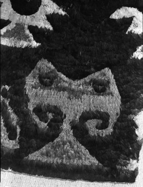 Chimú. <em>Fragment of Tunic or Tabard</em>, 1400-1700. Cotton, feather, 12 5/8 x 15 3/8 in. (32 x 39 cm). Brooklyn Museum, George C. Brackett Fund, 34.577. Creative Commons-BY (Photo: Brooklyn Museum, 34.577_detail_acetate_bw.jpg)