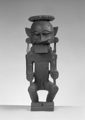 <em>Male Figure in Crouching Position with Long Earrings</em>, 19th century. Wood, 13 in. (33 cm). Brooklyn Museum, George C. Brackett Fund, 34.6074. Creative Commons-BY (Photo: Brooklyn Museum, 34.6074_acetate_bw.jpg)