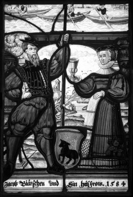 <em>Man and Woman with Uncovered Chalice</em>. Stained glass, 13 1/2 x 9 1/4 in. (34.3 x 23.5 cm). Brooklyn Museum, Gift of Mary Babbott Ladd, Lydia Babbott Stokes, Helen Babbott MacDonald, and Dr. Frank L. Babbott, Jr. in memory of their father, Frank L. Babbott, 34.6090.9. Creative Commons-BY (Photo: Brooklyn Museum, 34.6090.9_bw.jpg)