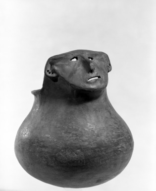 Southwest (unidentified). <em>Effigy Jar with Face modelled near rim</em>. Clay, slip, 6 11/16 x 5 1/2 in.  (17.0 x 14.0 cm). Brooklyn Museum, Brooklyn Museum Collection, 34.625. Creative Commons-BY (Photo: Brooklyn Museum, 34.625_bw.jpg)