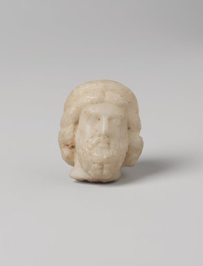 <em>Head of Asklepios</em>, 4th century B.C.E. Marble, 1 3/4 × 1 7/16 × 1 1/2 in. (4.5 × 3.6 × 3.8 cm). Brooklyn Museum, Charles Edwin Wilbour Fund, 34.713. Creative Commons-BY (Photo: , 34.713_front_PS11.jpg)