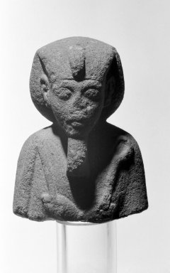 <em>Shawabti with Crook and Flail</em>, ca. 1352-1336 B.C.E. Sandstone, 4 7/16 x 3 3/8 x 1 3/4 in. (11.2 x 8.5 x 4.5 cm). Brooklyn Museum, Charles Edwin Wilbour Fund, 35.1531. Creative Commons-BY (Photo: Brooklyn Museum, 35.1531_front_view2_bw.jpg)