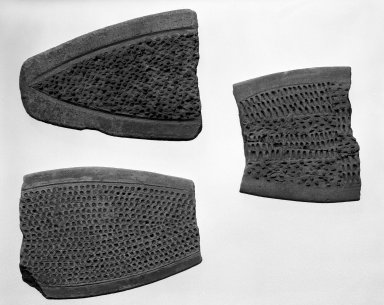 <em>Fragment of Cassava Grater</em>. Gray clay Brooklyn Museum, Frank Sherman Benson Fund and the Henry L. Batterman Fund, 37.3001PA. Creative Commons-BY (Photo: , 35.1750_37.3001PA_37.3004PA_bw.jpg)