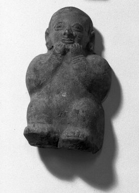 <em>Molded Figurine of Man</em>. Clay Brooklyn Museum, Ella C. Woodward Memorial Fund, 35.1777. Creative Commons-BY (Photo: Brooklyn Museum, 35.1777_acetate_bw.jpg)