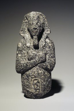 <em>Ushabti of Akhenaten</em>, ca. 1352-1336 B.C.E. Granite, 7 3/16 x 3 5/16 x 1 15/16 in. (18.3 x 8.4 x 5 cm). Brooklyn Museum, Charles Edwin Wilbour Fund, 35.1870. Creative Commons-BY (Photo: Brooklyn Museum, 35.1870.jpg)